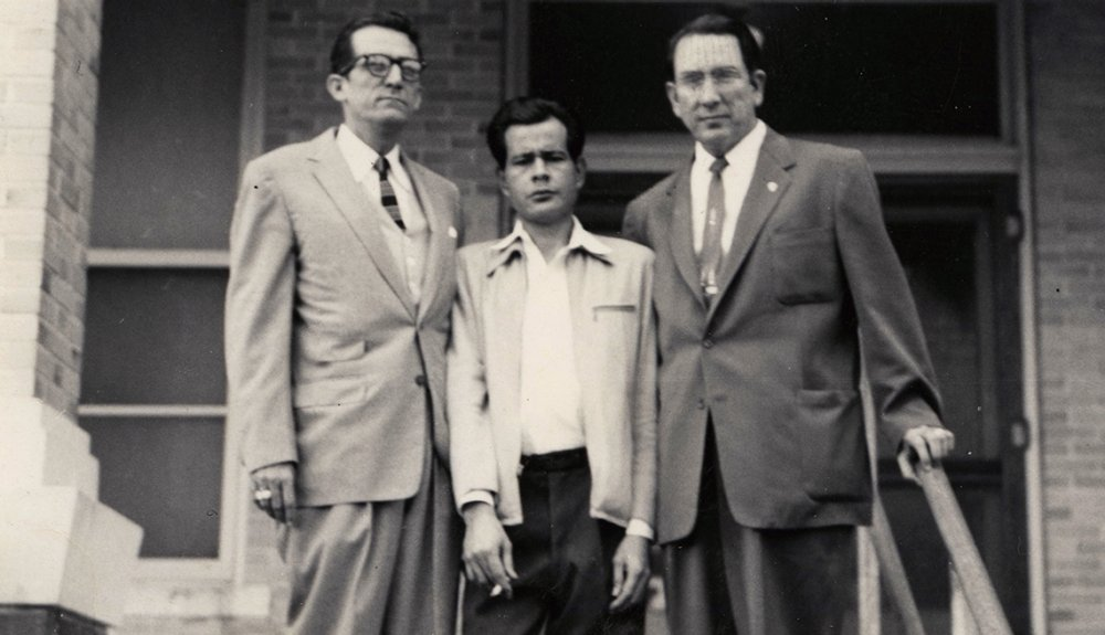 Attorneys Gus Garcia (left) and Johnny Herrera (right) stand with client, Pete Hernandez