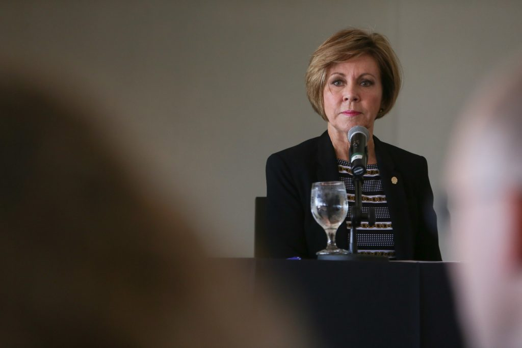 San Antonio City Manager Sheryl Sculley sits behind a microphone