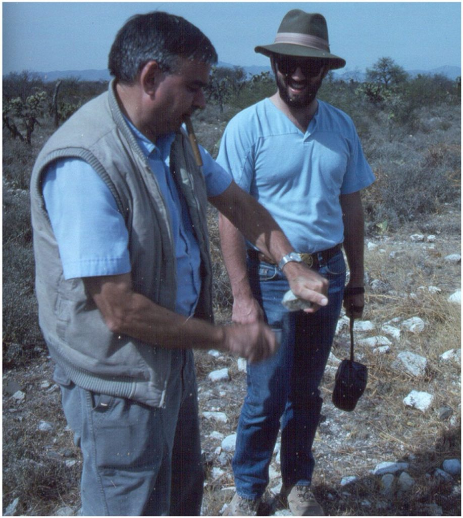 Photograph if Karl Butzer (on the left) demonstrating flint knapping to his student Thomas Hickson on a field trip to Mexico, taken around 1990