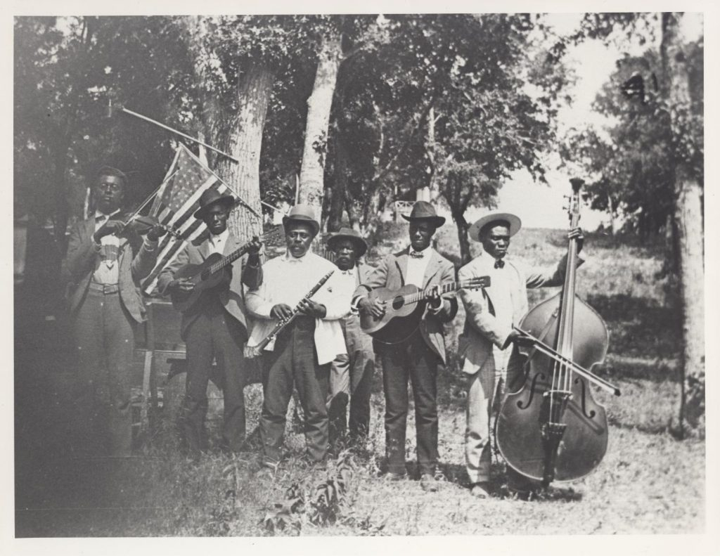 """African-American band at Emancipation Day celebration, June 19, 1900, held in """"East Woods"""" on East 24th Street in Austin"""