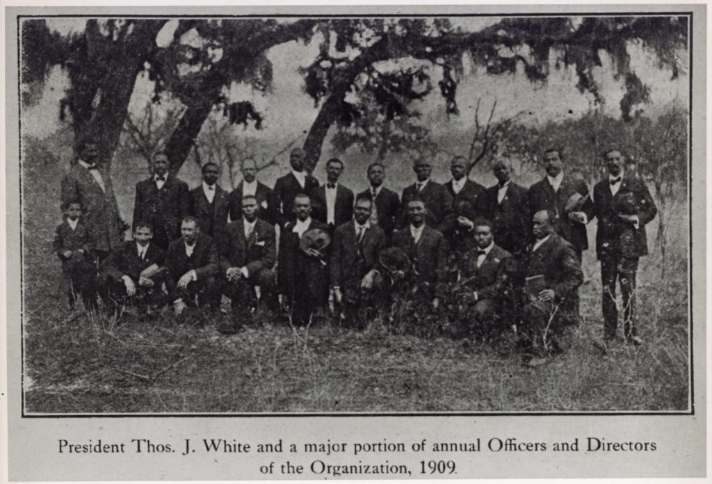 Officers and Directors of Austin, Texas Emancipation Park Association photographed in empty field