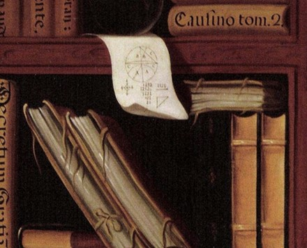 Close shot of the bookshelf in figure 1. It shows a piece of paper with geometric figures on it.