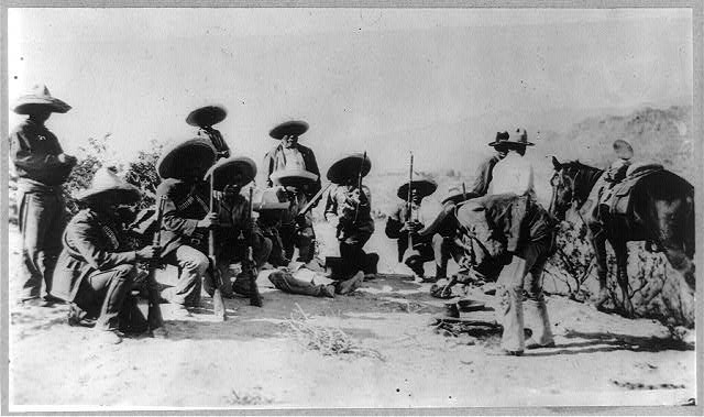 Black and white photograph of Mexican rebels camped outside Juárex, Mexico, 1911